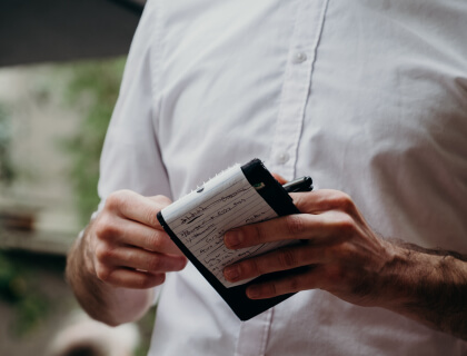 Waiter holding a notepad