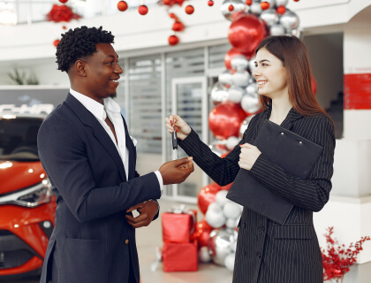 Woman handing car keys to a man