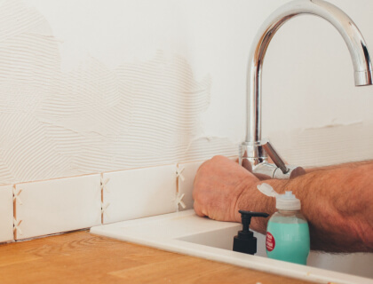 Man working on a sink